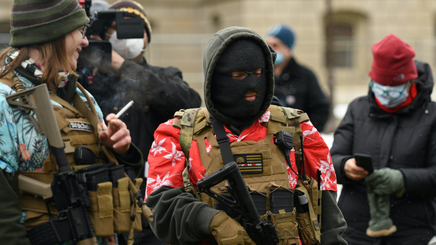 Armed protesters, including Boogaloo Boys, on the lawn of the Michigan capitol, denying the results of the recent election before the inauguration of Joe Biden in Lansing, Michigan, US on January 17, 2021. Photo:  Lester Graham