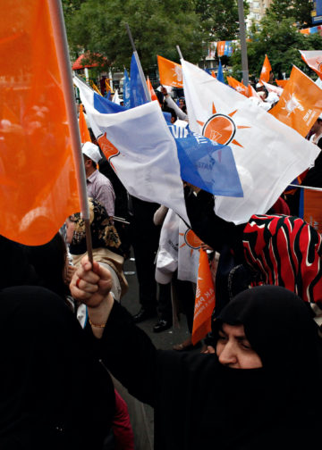 Supporters of ruling Justice and Development Party (AKP) wave party flags during an election rally in Istanbul on June 3, 2015.