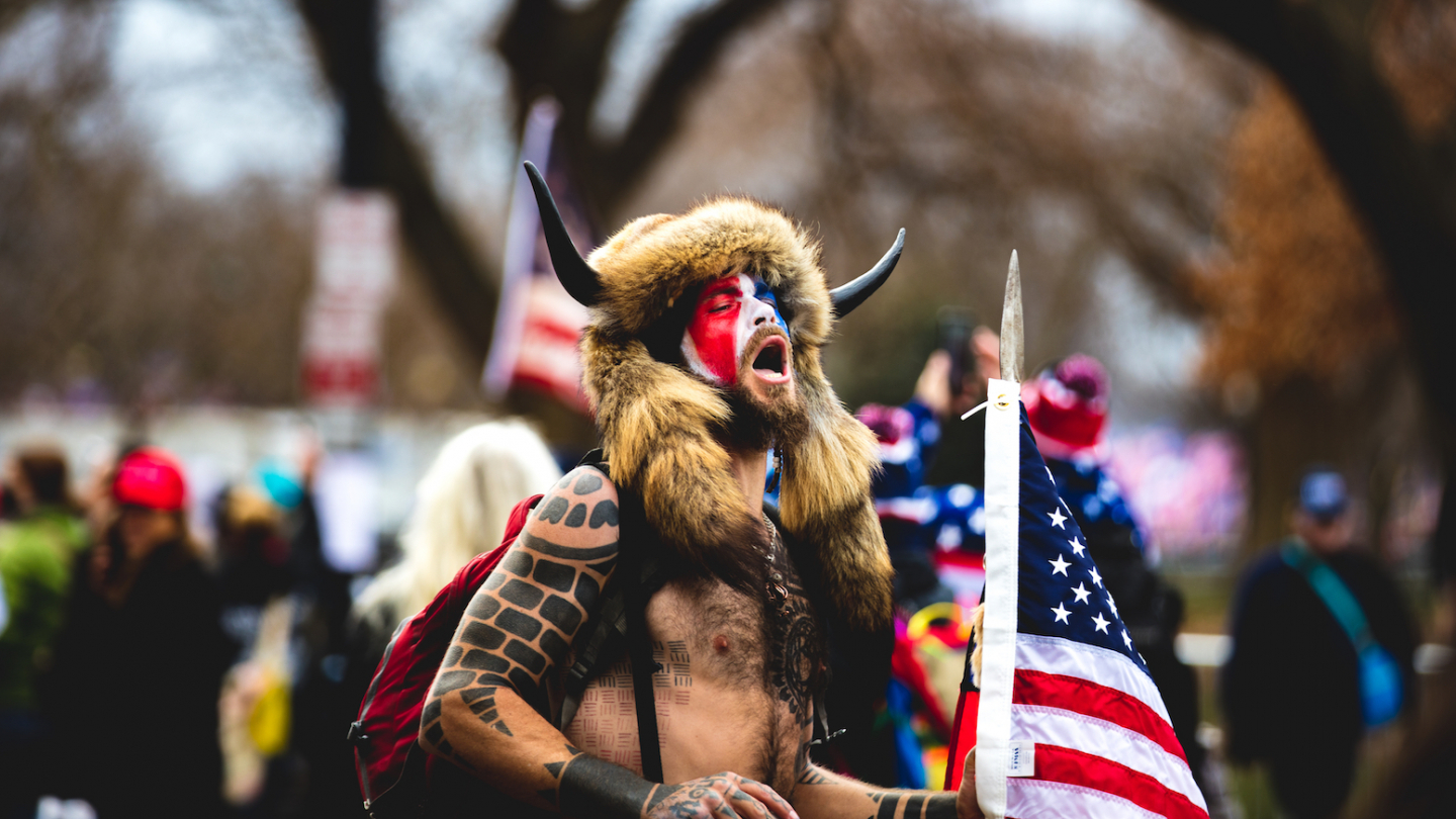 QAnon Shaman, Jake Angeli is seen as roaming  near the US Capitol during the January 6, 2021 insurrection which was initiated by Former US President Donald Trump in Washington D.C.. Photo: Johnny Silvercloud