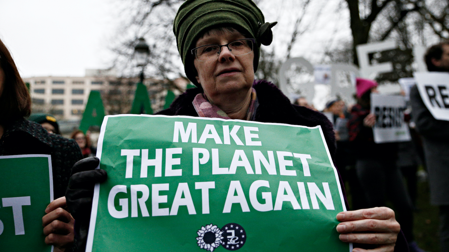 People hold placards and shout slogans during a protest against Donald Trump's environmental policy at conference attended by Trump climate advisor Myron Ebell in Brussels, Belgium on Feb. 2017. Photo: Alexandros Michailidis