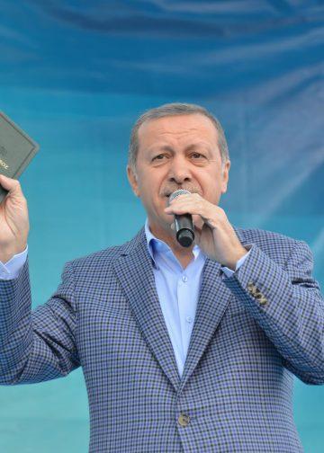 Turkish Islamist President Recep Tayyip Erdogan speaks in Van province of Turkey as holding a holy Quran on April 14, 2015.