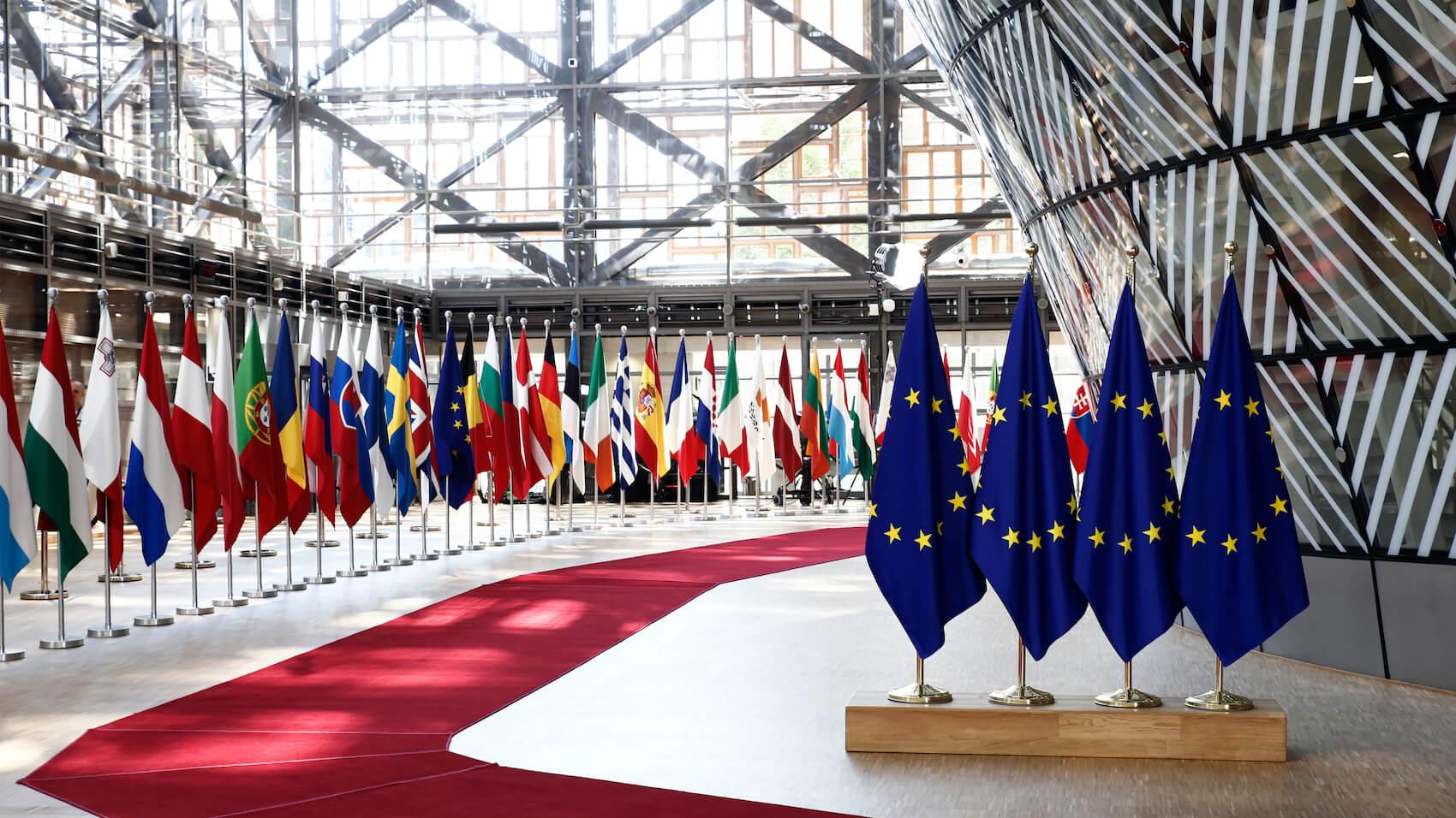 EU flags in EU Council building during an EU Summit in Brussels, Belgium on June 28, 2018. Photo: Alexandros Michailidis