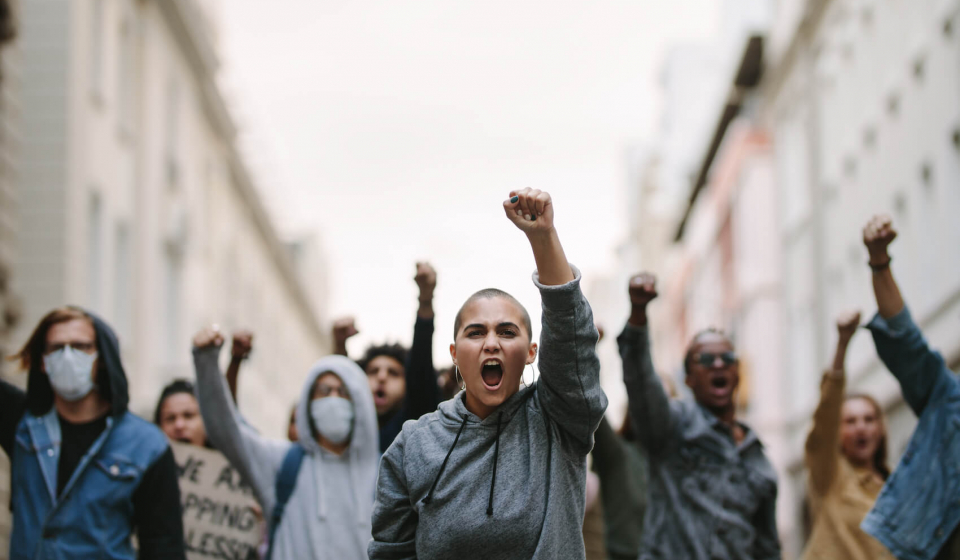 Group of people protesting and giving slogans in a rally. Photo: Jacob Lund.