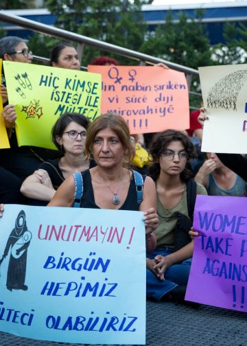 Demonstrators hold placards in support of Syrian refugees during a protest in Istanbul on July 27, 2019 against Turkish government's refugee policies. Photo: Huseyin Aldemir.